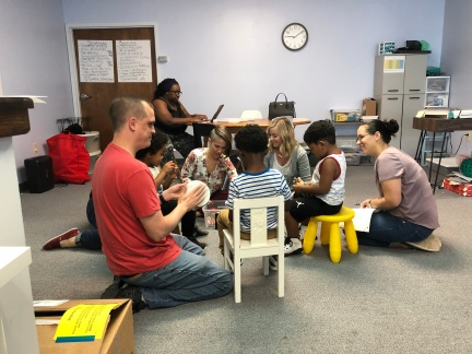 Kids working with staff
